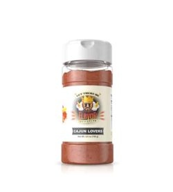 Clear bottle with red powder of Flavor God Cajun Lovers Seasoning shown in white background