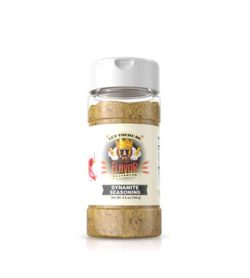 Clear bottle with light brown powder of Flavor God Dynamite Seasoning shown in white background