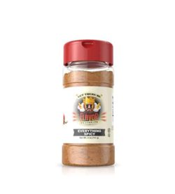 Clear bottle with red powder of Flavor God Spicy Seasoning shown in white background