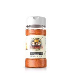 Clear bottle with brown powder of Flavor God Sweet and Tangy Seasoning contains net wt. 5 oz (141 g)