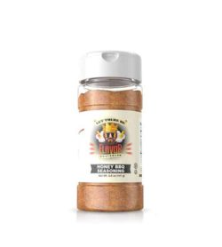 Clear bottle with brown powder of Flavor God Honey BBQ Seasoning shown in white background