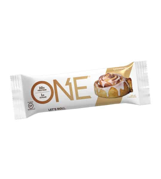 White and brown pouch of One Protein Bar Box Cinnamon Roll contains 20 g protein and 1 g sugar