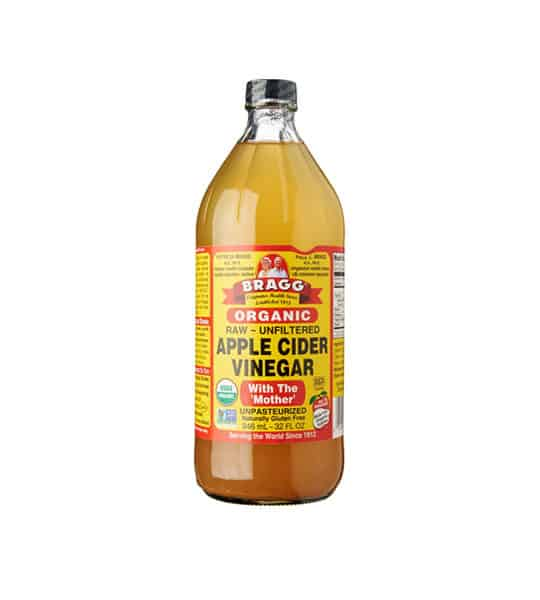 Orange bottle of Bragg Organic Raw Unfiltered Apple Cider Vinegar with the 'Mother' unpasteurized contains 946 ml