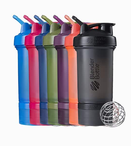 Blender Bottle Prostack sport mixer bottles of blue, red, green, purple, orange, and, black shown with mixer