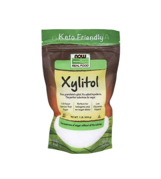 Brown and green pouch of Now Real Food Xylitol contains net wt 1 lit. (454 g)