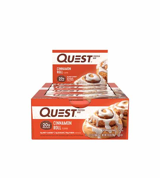 Orange box of 12 Quest Protein bars with Cinnamon Roll flavour each having 20 g protein shows glazed cinnamon bun on the package