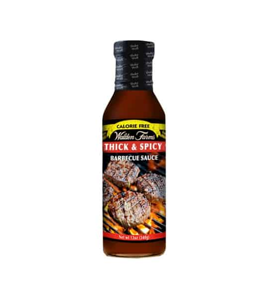 Brown bottle with black cap of Walden Farms Thick & Spicy Barbecue Sauce shown in white background