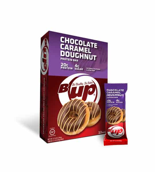 Red and purple box and pouch of BUp Chocolate Caramel Doughnut Protein Bars with 12 bars per box and each bar containing 20 g protein and 4 g sugar