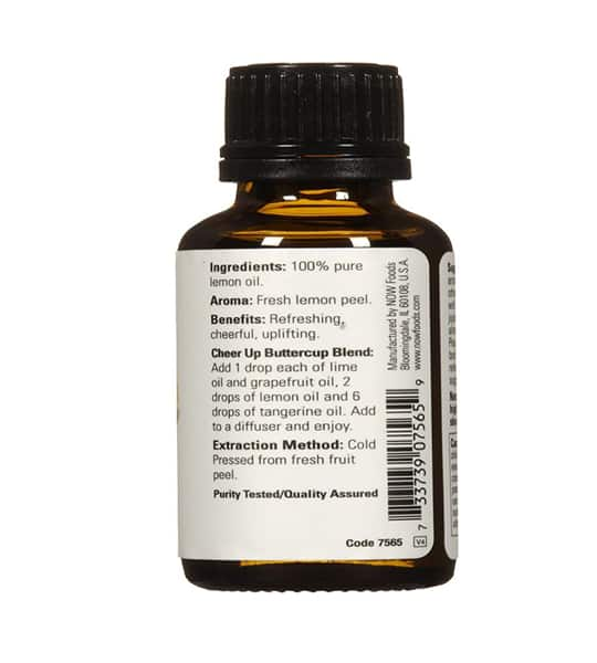 Brown bottle showing white ingredients label of NOW Essential Oils 30ml Lemon in white background