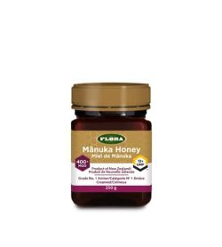 Clear bottle with gold cap of Flora Manuka Honey Product of New Zealand 400 MGO contains 250g