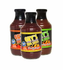 Three bottles of Guy's Award Winning BBQ Sauce Sugar Free in orange, yellow and green labels