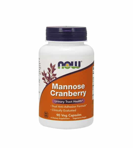 White bottle with purple lid of NOW Manoose Cranberry Urinary Tract Health dietary supplement containing 90 Veg Capsules