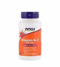 White and orange bottle with purple cap of NOW Vitamin K2 100-mcg Supports Bone Health 100 Veg Caps