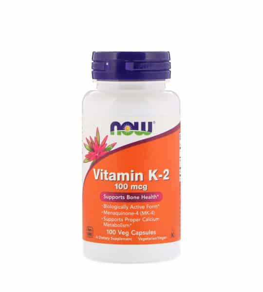 White and orange bottle with purple cap of NOW Vitamin K2 100-mcg Supports Bone Health 100 Veg Caps