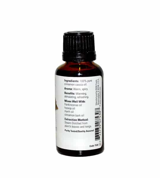 Brown and white bottle showing back side of Now Cinnamon Cassia Oil 30 ml