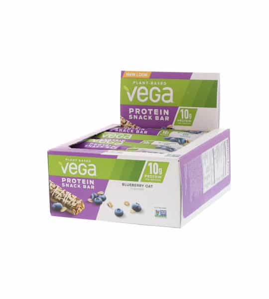 Purple and white box shown open of Vega plant based protein snack bar with blueberry oat flavour