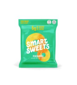 green bag of smart sweets peach rings white writing with candy peach rings behind vegan health snacks