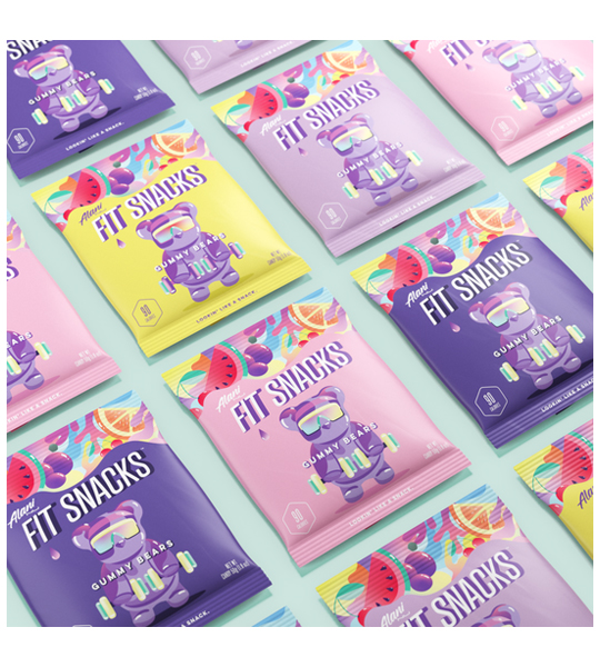 Pink, purple, and, yellow pouches of AlaniNu Fit Snacks Gummy Bears 50 g shown in light green background