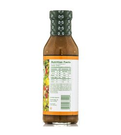 One white and orange bottle of Walden Farms Sesame Ginger 355ml showing nutrition facts